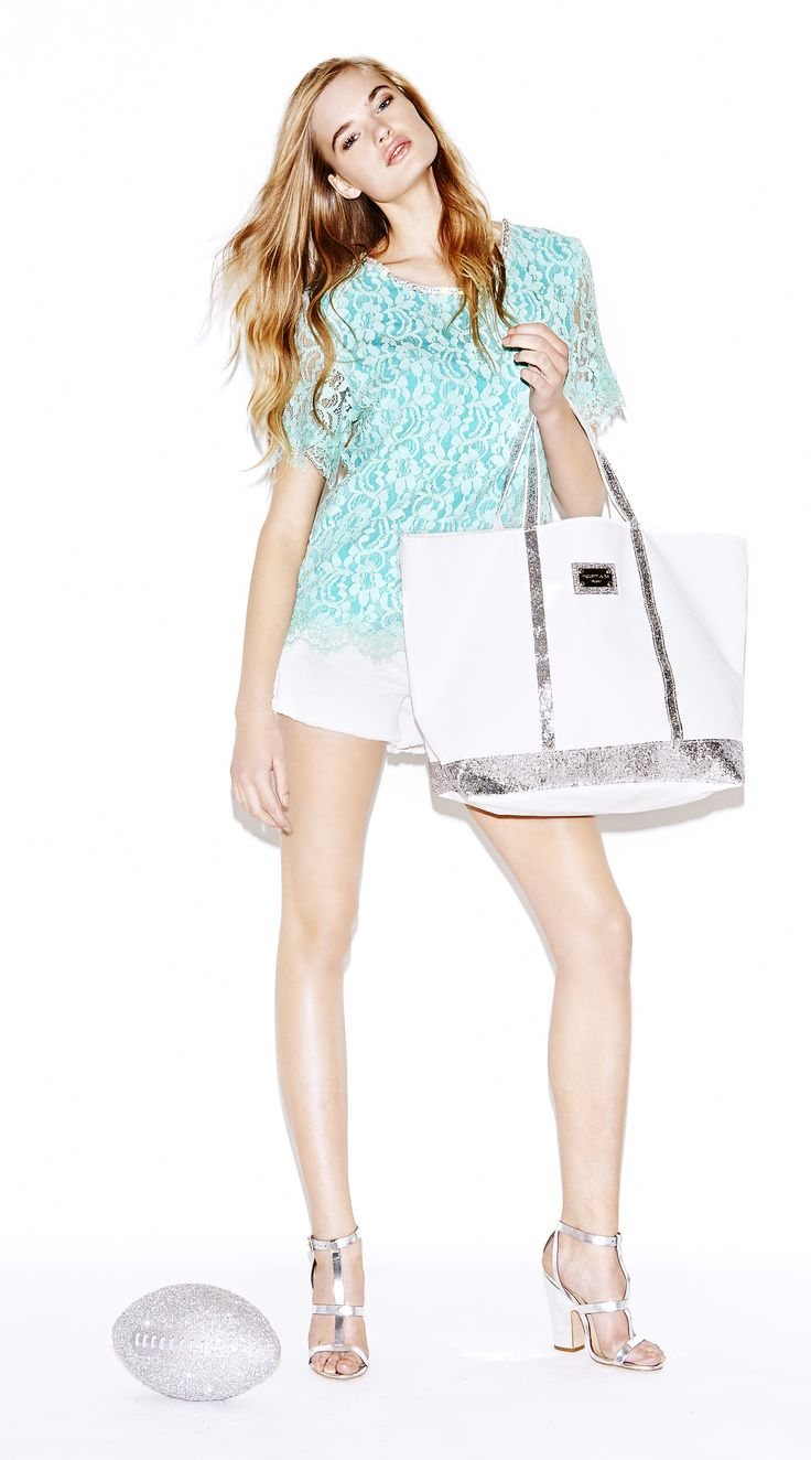 Model wears Naughty Dog SS14 lined lace t-shirt. with Swarovski on the neckline; five-pocket denim shorts also decorated with Swarovsk crystals; canvas shopping bag with glitter inserts and handle.