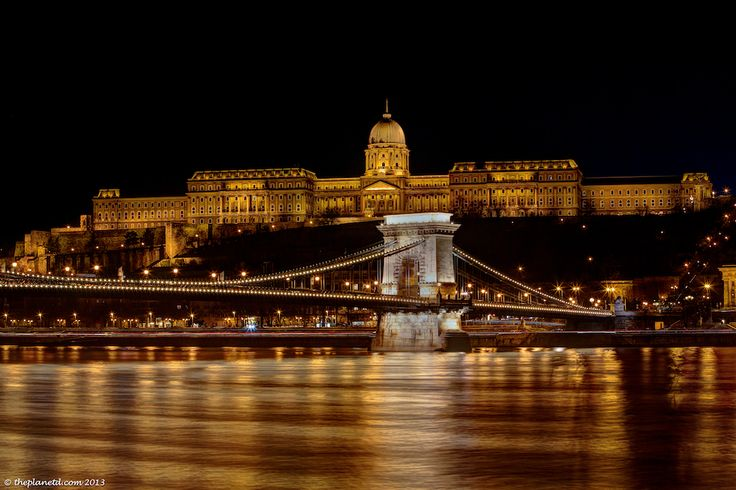The Budapest Chain Bridge at Night : February was a very busy month for us as we jetted around Europe with HouseTrip. We were excited to witness the city of Budapest because we had always heard it was the most beautiful city in all of Europe. It did not disappoint. We truly believe that it is, especially at night when the waterfront is lit up.