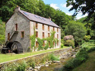 West Wales.  A watermill in a secluded valley with riverside gardens.