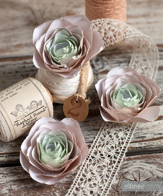 Over at Elinee, Lia shows us how to make pretty paper ranunculus  (which is a type of rose)  -- printable pattern included!