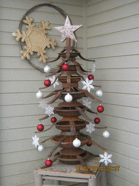 A Christmas tree made from artfully stacking rusted Christmas tree stands (by Mary Jo Bowling)