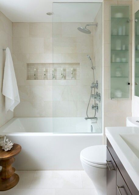 Example of light neutral colour scheme with tiling right up to the ceiling. Original pinner said: Love this small bathroom! The in studs shelf, glass and tiles! How can we work this around window?