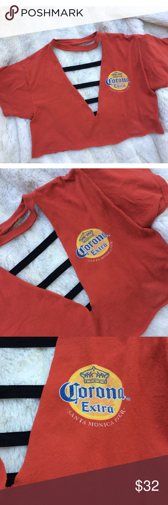Custom Corona Santa Monica Beach Cut Out Crop Top Rare custom one of a kind shirt, handmade similar to LF. Orange color vintage santa monica beach Corona beer t-shirt, hand cut with professional scissors, perfect bathing suit cover up or over a cute bralette. Good condition minimal wear no significant flaws. Open back with sewn on black edging lining back ladder style. One size fits most, can fit best small/medium NOT LF tagged for similar style. FREE SURPRISE GIFT WITH EVERY ORDER! LF Tops…