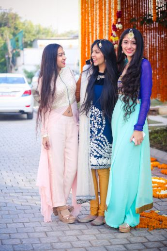 mint and navy long kurta, with a little gold work on the front, big slits on the side; wide legged mint pants