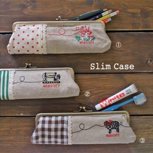 """Biscuit Slim Case by Decole Japan!  Perfect for your pencils, cosmetics etc.  It comes in 3 different character design; Mushroom, Sewing Machine and Sheep!      Size: 8.3""""x 3""""x 1.2"""""""