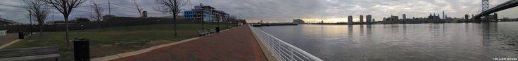 Fifteenth November 2017 Panorama taken with smartphone of the waterfront, Delaware River, Philly Skyline and the Ben Franklin Bridge.