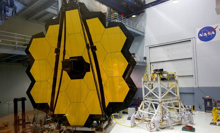 The James Webb Space Telescope Mirror is seen during a media unveiling at NASA's Goddard Space Flight Center at Greenbelt, Maryland, on November 2, 2016. The telescope is set to be launched into space in October of 2018, and will be positioned nearly a million miles from the Earth.