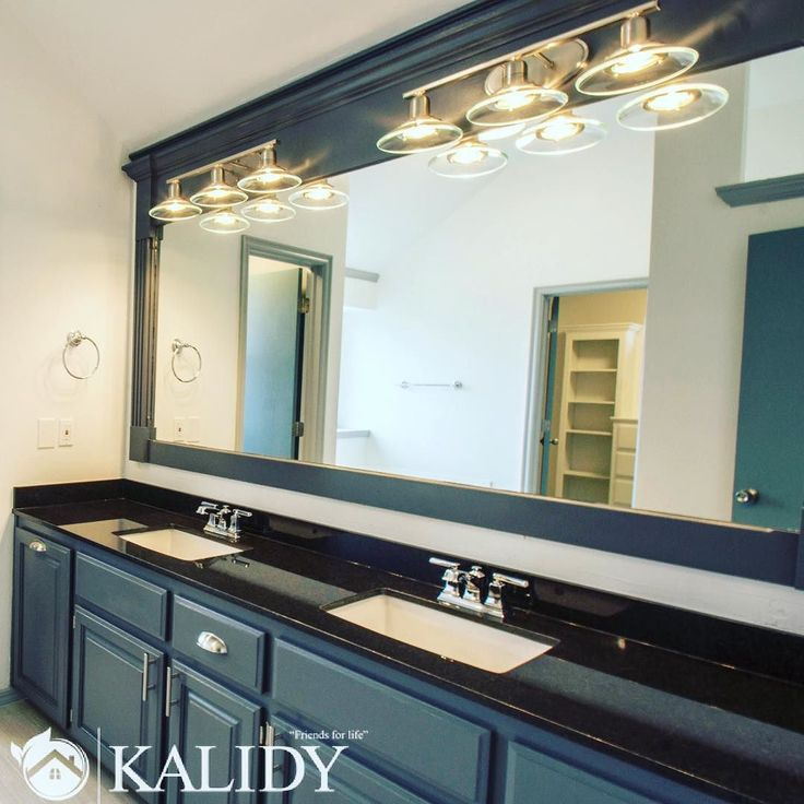 Ever wondered what to do with a long bathroom wall? Fill it with a vanity and a huge horizontal mirror! Not only is it a quick fix to fill the space but it also creates an optical illusion of more square footage! Plus it allows you to have fun with granite colors and vanity lighting!