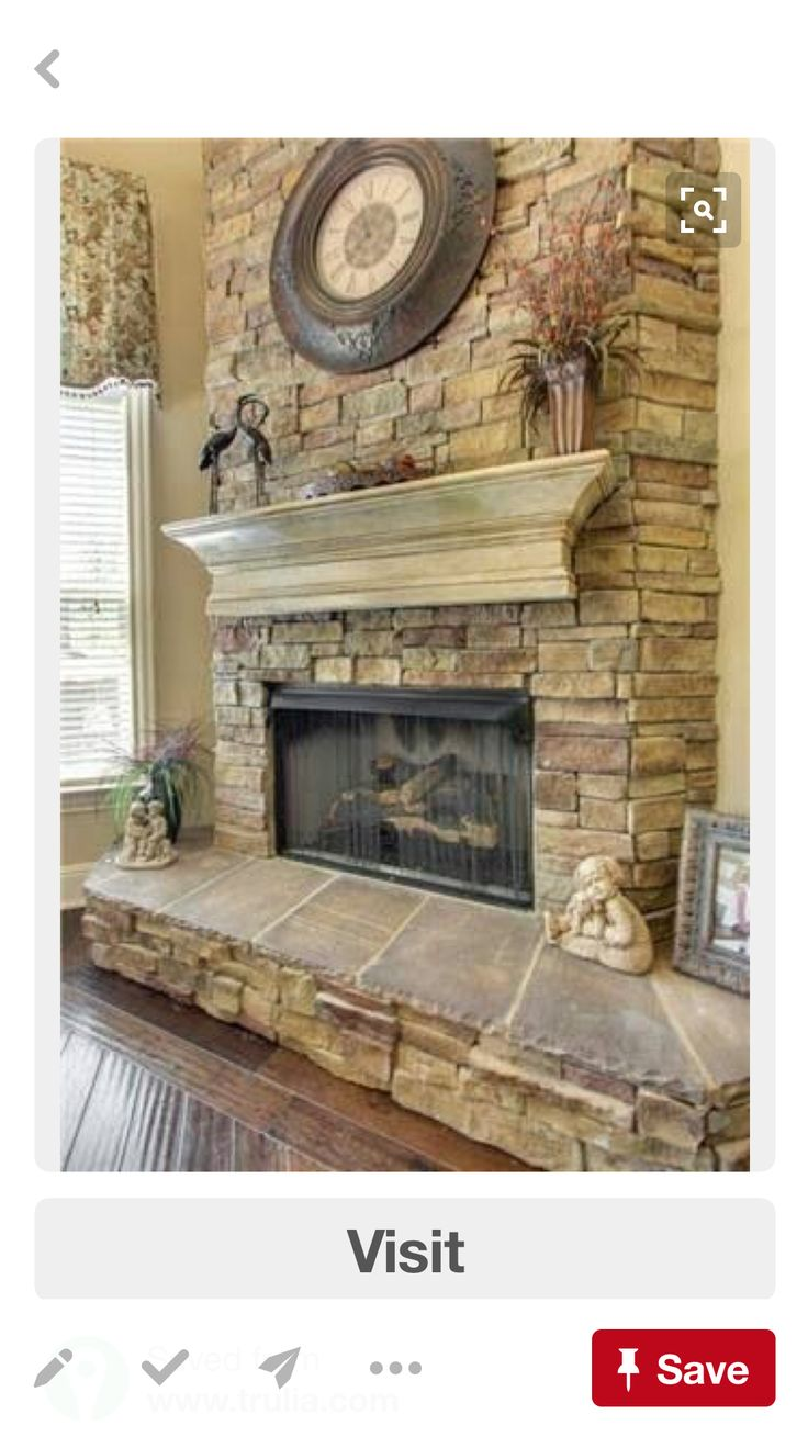 stack stone fireplace with a distressed mantle more ms
