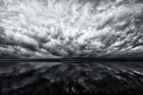 Heavy Dramatic Clouds and Their Reflection in Calm Water - Fotografiskt tryck av Jonathan Irish på AllPosters.se