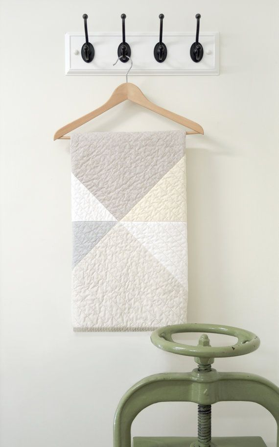 Modern Geometric Crib Quilt: great idea when you need a quilt in a pinch.  Sew pieces together and then cut out square  Perf