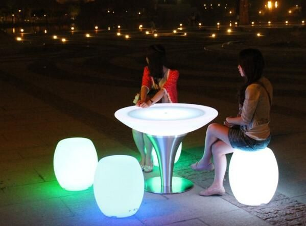 Glowing stools and table.