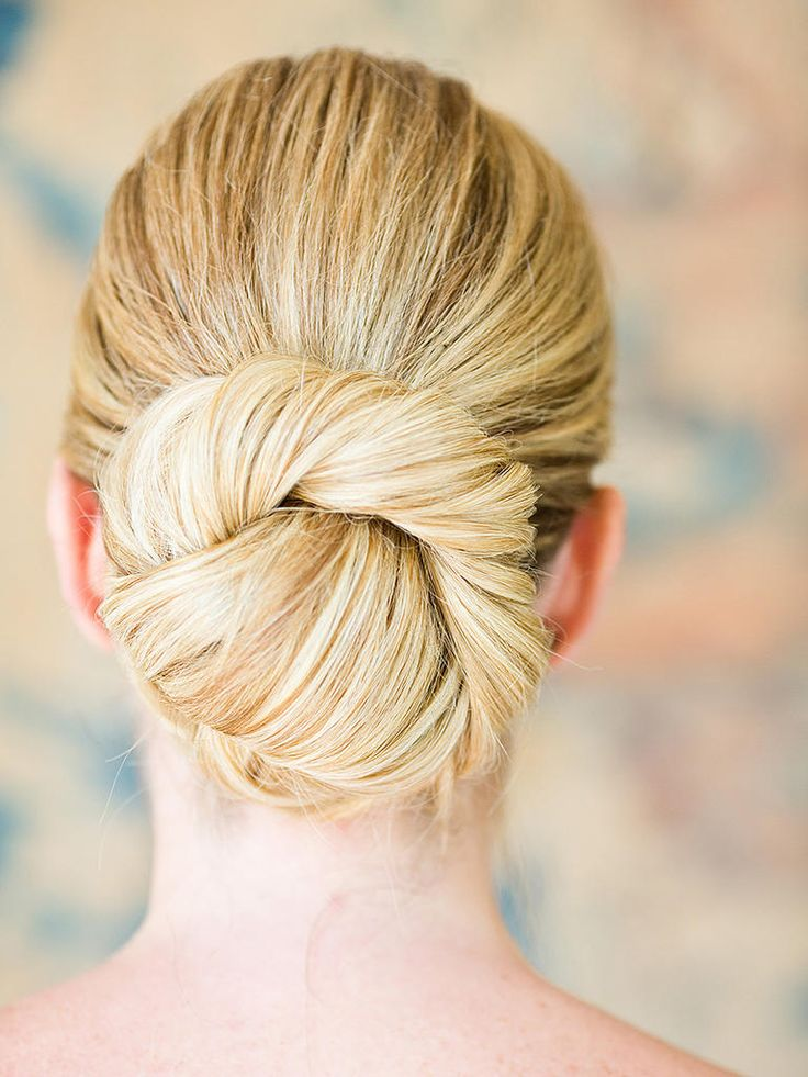 Keep it simple and classic with an elegant twisted ballerina bun for your wedding hairstyle.