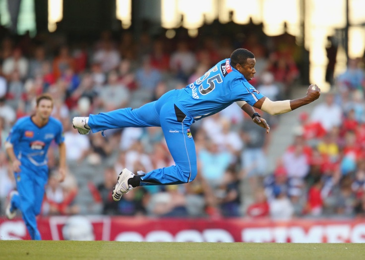 MELBOURNE, AUSTRALIA - JANUARY 02: Kieron Pollard of the Strikers takes a catch off his own bowling to dismiss Ben Rohrer of the Renegades during the Big Bash League match between the Melbourne Renegades and the Adelaide Strikers at Etihad Stadium on January 2, 2013 in Melbourne, Australia. (Photo by Scott Barbour/Getty Images)