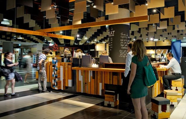 Streat, a freestanding cafe on the ground level concourse of Melbourne Central by Six Degrees Architects