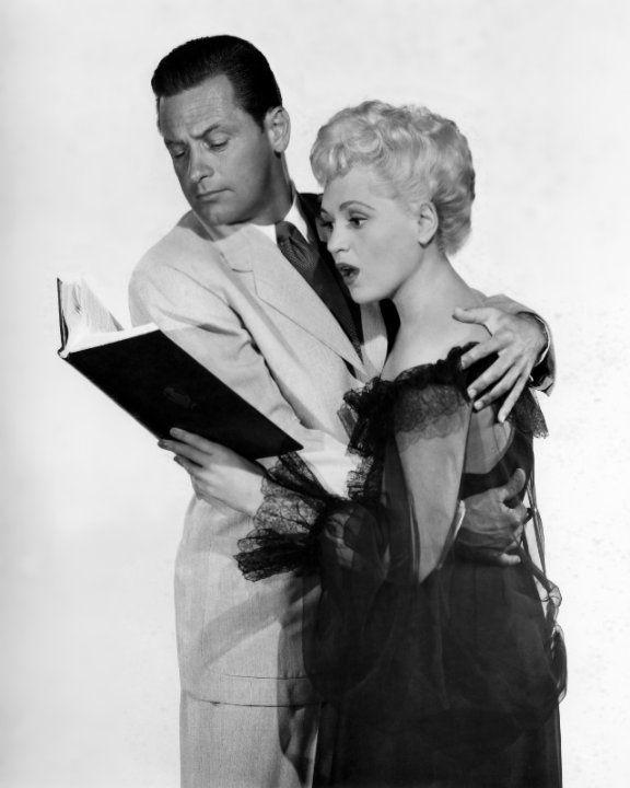 Still of William Holden and Judy Holliday in Born Yesterday (1950)