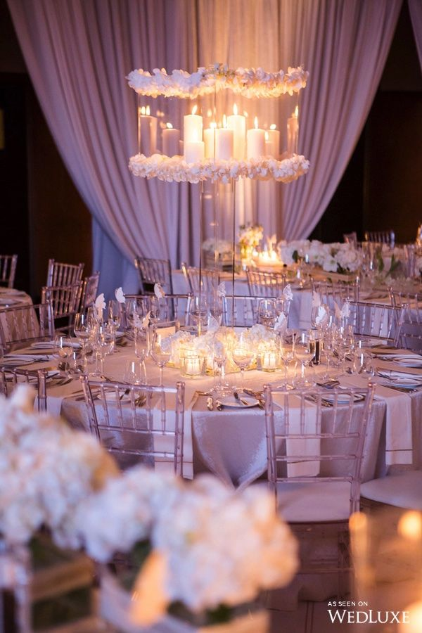 This Glowing Centerpiece Adds A Romantic Feel to the Reception. | Photography By: Ikonica | WedLuxe Magazine | #wedding #weddinginspiration #luxury #weddingreception #tablescape #decor #centerpiece