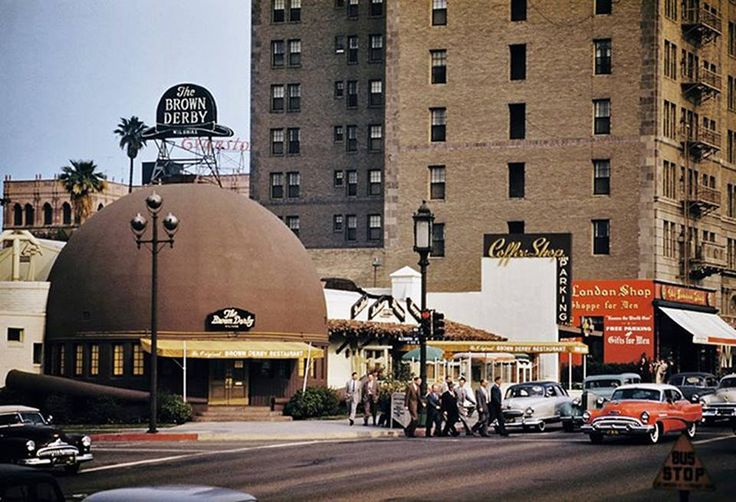 I always love coming across a photo of the original Brown Derby on Wilshire Blvd that I haven't seen before—especially if it's in color! My friend at the Petersen Automotive Museum tells me that the red car on the right is a 1953 Buick, so I'm going to say this was taken circa 1953. I've also never noticed our striking the red sign for the London Shop (menswear) was. I'm thinking they needed to do something to put everyone's attention from the iconic eatery.