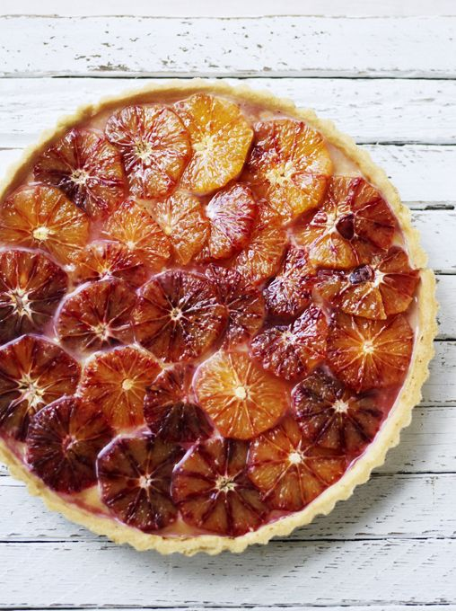 Try serving this twist on the classic lemon tart decorated with slices of caramelised blood oranges for a pretty finish.