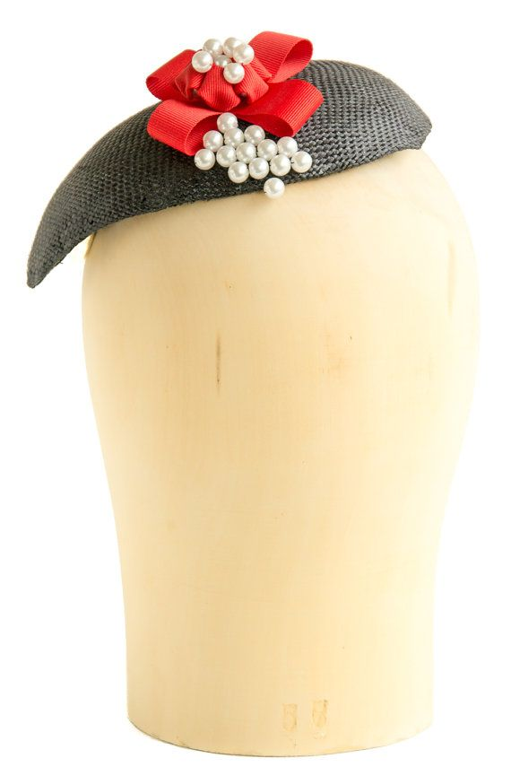 Handmade tear-shaped black paper straw fascinator. Finished with red bow and pearls. Attaches with millinery elastic. #millinery #2016