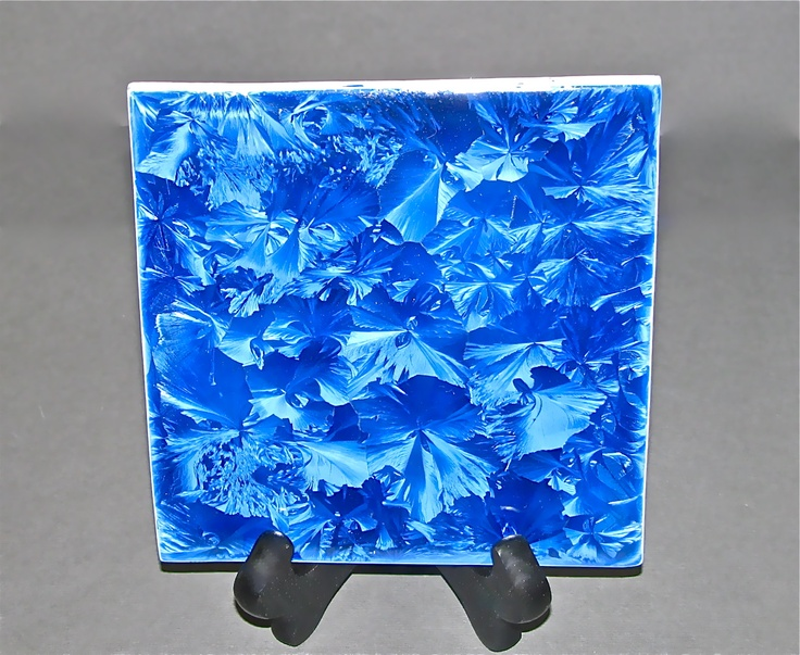 "6"" blue crystalline tile on a display stand."