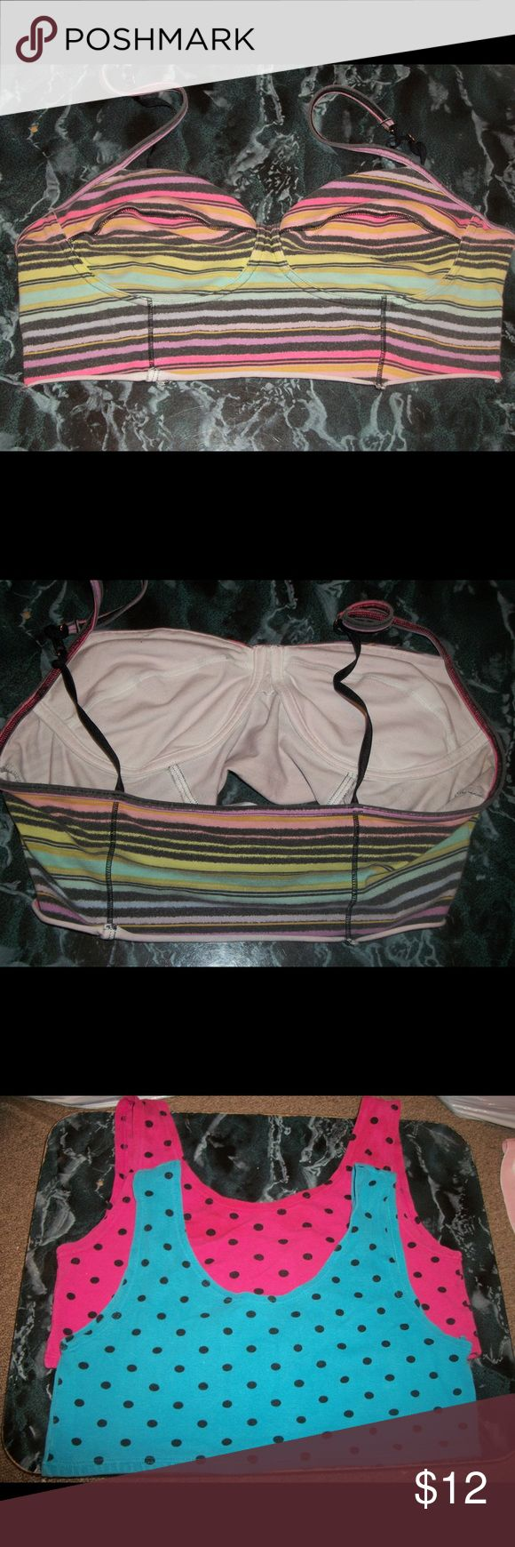 Stretchy Bras Up for sale is 4 bras in good condition. V.S. Colorful Stripes Cotton Stretch Bra Top Size M A'Milano Pink & Black Polka Dot Cotton StretchBra Top Size M A'Milano Blue & Black Polka Dot Cotton Stretch Bra Top Size M Hanes Pink Cotton Stretch Bra Top Size M No Name Brand Light Blue Lace Stretch Bra Top Size M Bravadol Animal Print Cotton Stretch Bra Size L Intimates & Sleepwear Bras