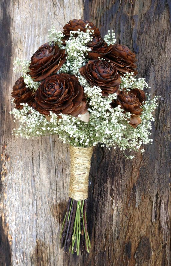 A simple winter wedding bouquet of pine cones and dried babys breath with your choice of stem wrap in satin ribbon colors, up-cycled coffee bag burlap or sisal twine. You can customize this bouquet made with pine cones or with cedar rose cones.  Approximate Measurements: 15 high with a 7 inch handle by 8- 9 wide (approximately 27 inches around). There is some variation from one to another.  Sisal twine stem wrap is pictured in the photo above. This listing is for one made to order bouquet…