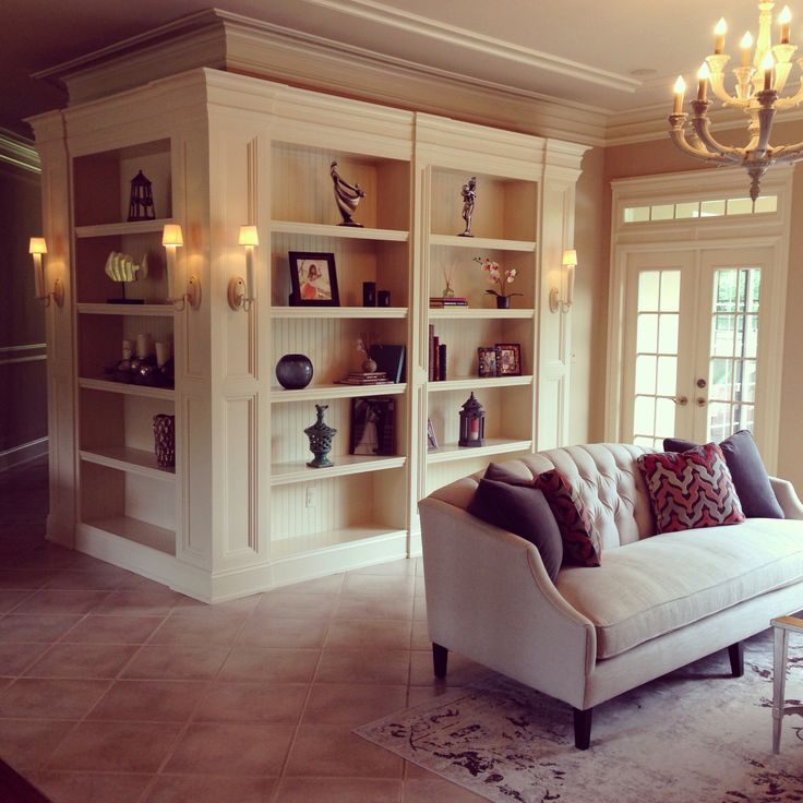 Bookshelves between formal living and dining room