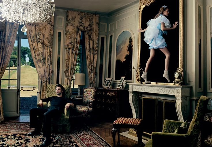 Natalia Vodianova slips through the looking glass at the Château de Corbeil-Cerf as Nicolas Ghesquière stares off.