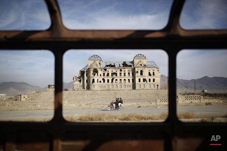 People pass by the Darulaman Palace in Kabul, Afghanistan. Photographer: Alexandre Meneghini AP Images: Blog | Facebook | Twitter | Instagram | License this photo
