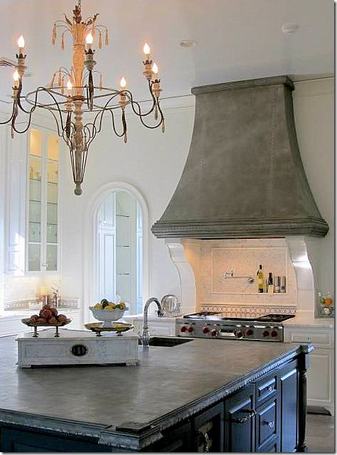 "ok, it's not really ""farmhouse"" style, but WOW is it gorgeous!!   LOVE the range hood!"