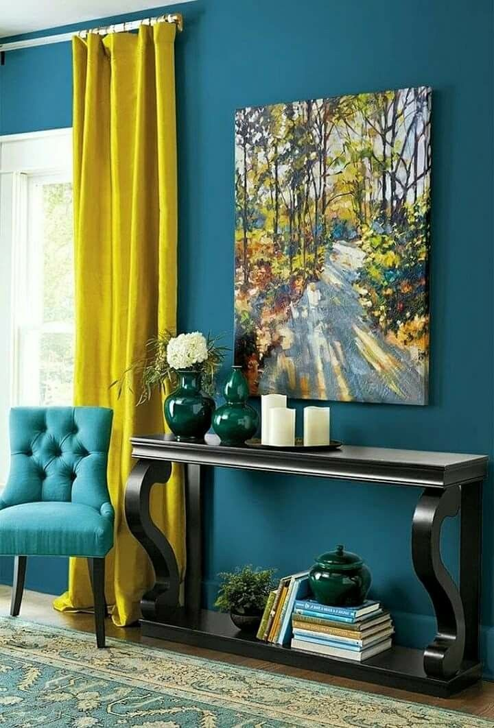 Home Decor Featuring Teal Walls And Mustard Curtains An Upholstered Chair Oak Table And Wall Art Finish Living Room Decor Living Room Color Room Paint Colors #teal #and #mustard #living #room