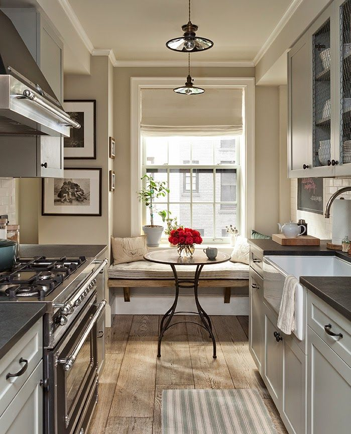Small Galley Kitchen Features Upper Cabinets With Chicken Wire Doors Over  Light Gray Shaker Cabinets Paired With Honed Black Countertops Framing A  Farmhouse ...