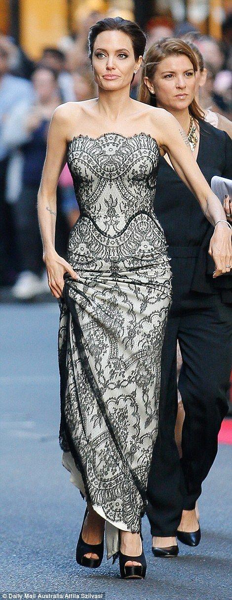 Angelina Jolie arrives at Unbroken premiere in Sydney with Brad Pitt #dailymail