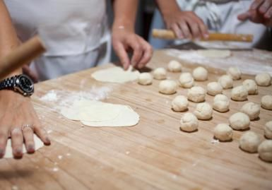 Rolling out dough for empanadas - Lara Hata/Photodisc/Getty Images