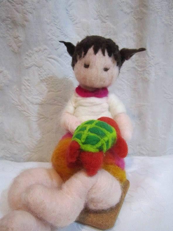 niña con tortuga