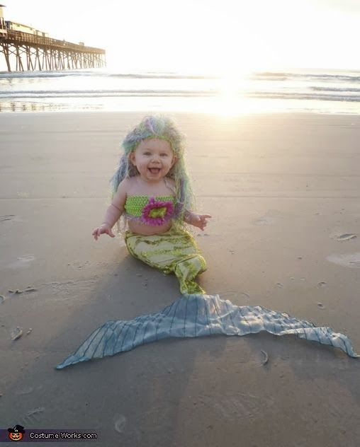 I found a picture of you as a baby mermaid when your hair was diyed ok it looks nothing like you but it's a baby in a mermaid costume