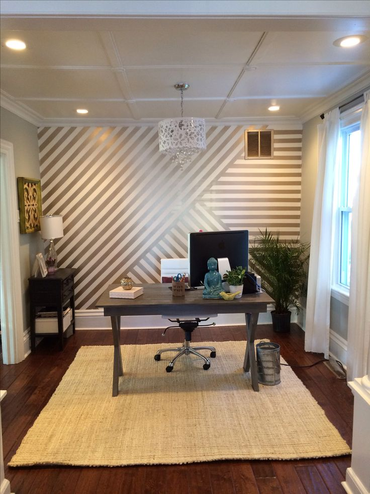 My new home office! Gold stripes- maybe chevron ish?  Diy desk with X legs, jute rug and a white chandelier from Overstock. Turned out so pretty!!!