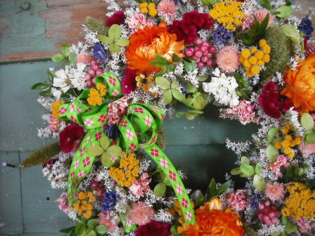 Dried flower spring wreath via NHWoodscreations on Etsy.  Love how vibrantly colored it is.