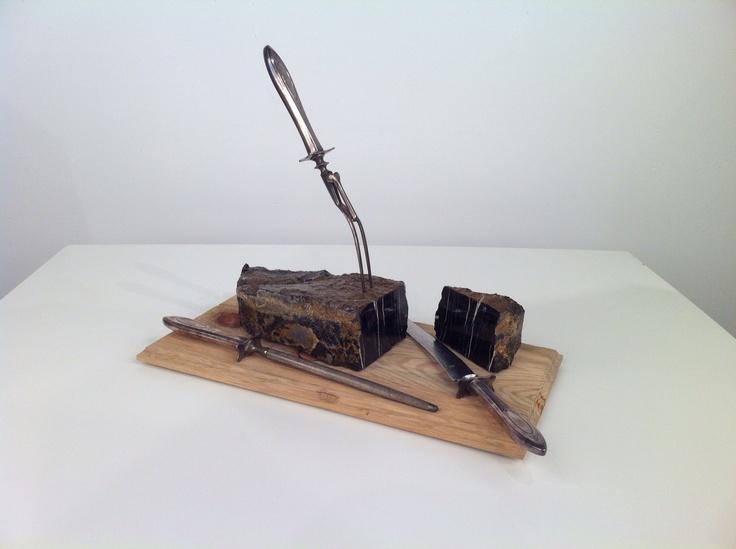 """ Rocky Mountain brisket""  Rocky's rock, wood and antique silverware"