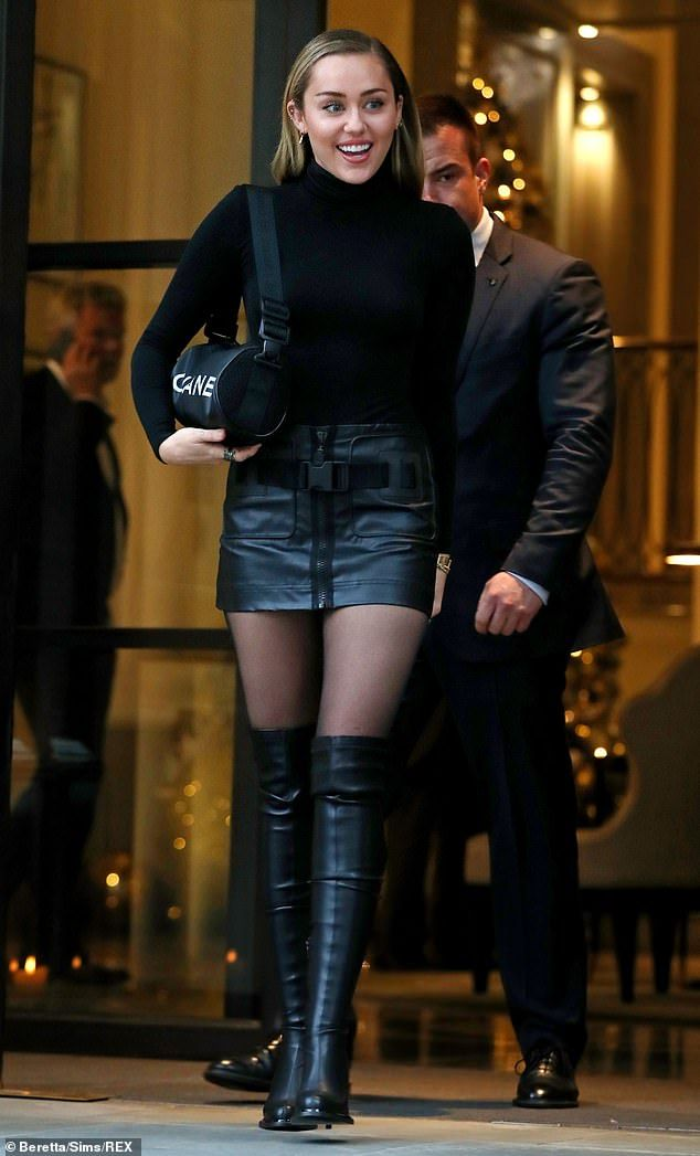 831bb573c Miley Cyrus sizzles in mini skirt and sexy thigh-high boots in London