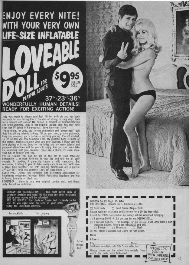 Pretty sure that doll is a woman. And also, the man is flipping off the camera.