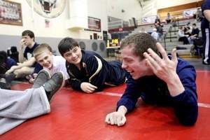 Unable to walk, Fairdale wrestler Willie Burton grapples with cerebral palsy