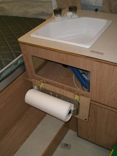 .. check it out .. what a good idea!! Paper towel holder for tent trailer. Genius!
