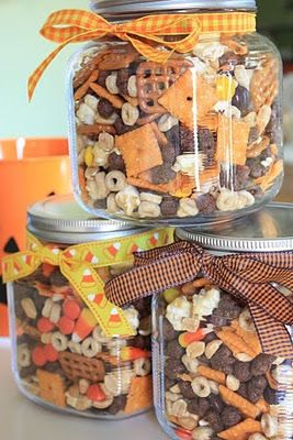 seriously this looks so good. we are going to do this!  cheese crackers, salted peanuts,   and pretzel squares.    Then the sweet stuff was added:  Reese's candy bits,caramel corn,   honey nut cheerios,cocoa puffs,   candy corn,and  mellowcreme pumpkins.