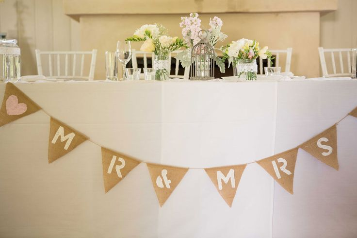 BRIDAL TABLE. Mr & Mrs bunting decorates this pretty bridal table. Wedding hire: Tiffany Chairs.Photography: www.mintphotography.com.au. Wedding Gallery | Hire Ideas & Inspiration | Your Event Solution | YES #weddings #YourEventSolution