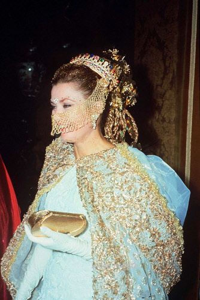 Princess Grace of Monaco is all decked out with a jeweled mantilla and an Arab-style face veil as she arrives for a masked ball at the Ca Rezzonico in Venice in 1967.