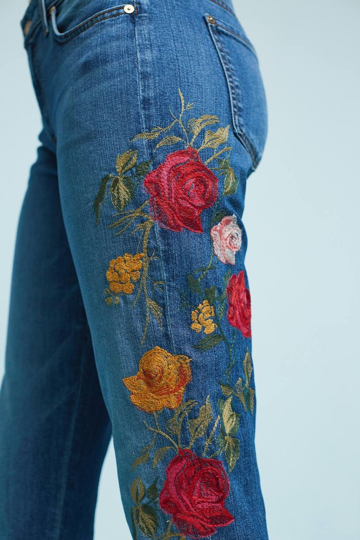 Vibrant floral embroidery adorns this classic straight pair in a versatile rinse