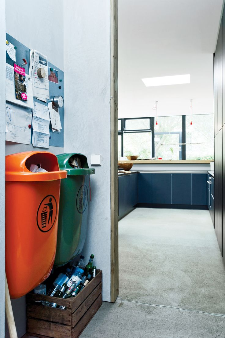 Bring In the Trash  With an eye for the industrial, Winterhalder built the garbage area in the kitchen around two standard-issue plastic trash cans common in German cities. One is orange; the other, green. These in turn inspired her to start adding color accents around the house.
