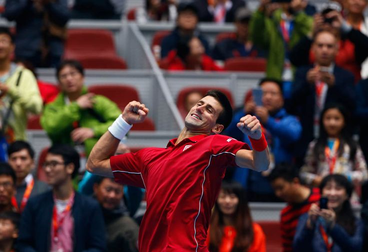Novak Djokovic of Serbia celebrates after winning against Andy Murray of Britain during their men's singles semi-final match at the China Open tennis tournament in Beijing October 4, 2014. (REUTERS/Petar Kujundzic)
